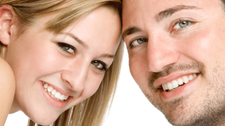 Beautiful happy couple with healthy smiles